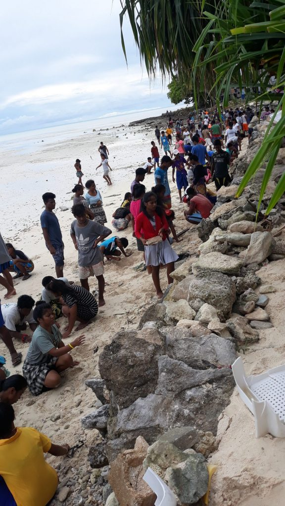 Holding back the tide: Students repair the sea-wall on Tarawa